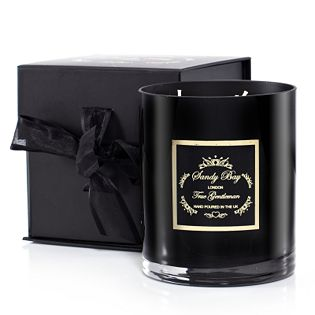 Sandy Bay Ticklish Pear three wick candle. Features a striking candle on an elegant black dish with three wicks and the scents of delicate pear essence, warm aromatic Amazonian tonka and Moroccan armoise. Gorgeous and relaxing, this scented candle is the perfect backdrop to a quiet evening with family and friends.